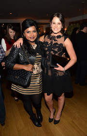 Mindy Kaling toughened up her frock with a black leather jacket for the Golden Globe Awards season celebration.