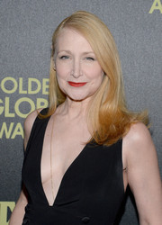Patricia Clarkson styled her hair in a long-side part and wavy cut.