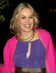 Sharon Stone added a thick gold embellished necklace to her bright look at the Hollywood Reporter Big 10 party.