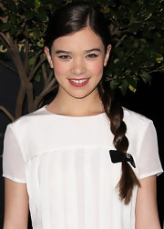 Hailee Steinfeld paired her winter white frock with a girlish braid parted on the side.