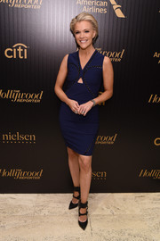Megyn Kelly showed some skin in a short navy cutout dress at the Hollywood Reporter's 35 Most Powerful People in Media event.