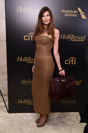 Carol Alt proudly showed off her burgundy crocodile Birkin.