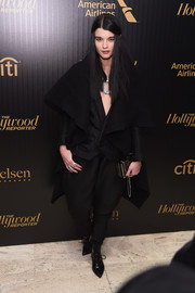 Crystal Renn looked avant-garde in a black blanket coat teamed with a baggy pantsuit at the Hollywood Reporter's 35 Most Powerful People in Media event.