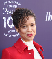 Gugu Mbatha-Raw swiped on some red lipstick to match her coat.