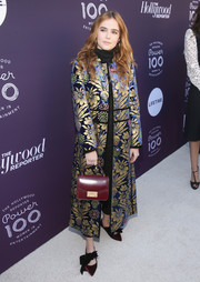 Zoey Deutch polished off her look with a pair of bowed velvet pumps.