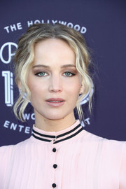 Jennifer Lawrence styled her hair into a messy-glam updo for the Hollywood Reporter's 2017 Women in Entertainment Breakfast.