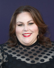 Chrissy Metz styled her hair with an off-center part and curly ends at the Hollywood Reporter's 2017 Women in Entertainment Breakfast.
