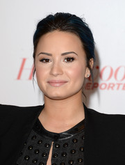 Demi Lovato played it down with this casual bun at the Women in Entertainment Breakfast.