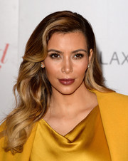 Kim Kardashian looked sultry with her retro waves during the Women in Entertainment Breakfast.