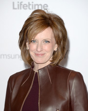 Anne Sweeney styled her hair with high-volume, textured layers for the Women in Entertainment Breakfast.
