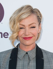 Portia de Rossi looked lovely with her partially braided waves at the 2014 Women in Entertainment Breakfast.