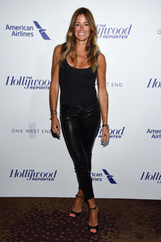 Kelly Bensimon completed her all-black look with a pair of peep-toe heels.