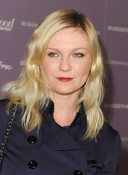 Kirsten Dunst wore a vibrant shiny cranberry lipstick at the Women in Entertainment breakfast.