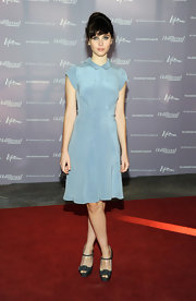 Felicity Jones paired her icy blue frock with strappy platform sandals.