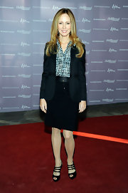 Dana Walden opted for a dark suit paired with black strappy sandals with subtle buckled detailing.
