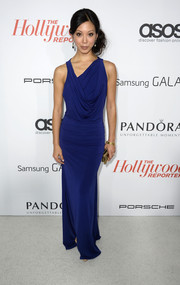 Brittany Ishibashi looked dramatic in a draped blue evening dress with an asymmetrical neckline during the Hollywood Reporter Emmy party.