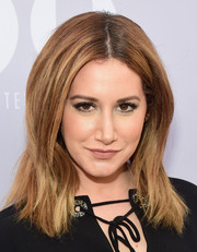 Ashley Tisdale attended the Women in Entertainment Breakfast wearing this center-parted layered cut.
