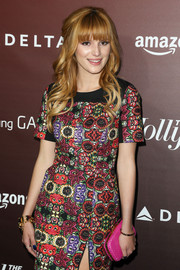 Bella Thorne paired a neon-pink hard-case clutch with a print dress for a colorful finish at the Next Gen 20th anniversary gala.