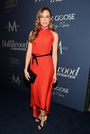 Jessica McNamee looked exquisite in this orange silk asymmetrical dress at the Oscar nominees luncheon in Hollywood.