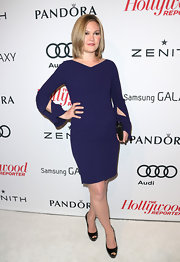 Julia Stiles wore a sleek purple dress with elegantly slashed sleeves for the Hollywood Reporter soiree.