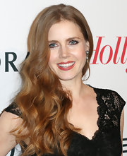 Amy Adams transformed her long, vibrant tresses into a cascade of curls for The Hollywood Reporter Nominees' Night 2013.