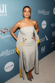 Susan Kelechi Watson complemented her dress with pointy gray pumps.