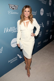 Rita Wilson styled her dress with a pair of pink ankle-tie pumps.