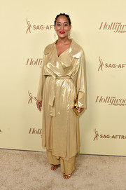 Tracee Ellis Ross wore a gold duster coat and matching pants by Norma Kamali to the Hollywood Reporter and SAG-AFTRA Emmy nominees night.