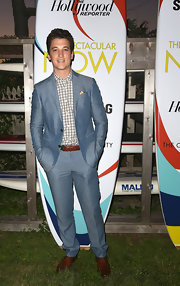 Miles kept it classy with a summery blue linen suit over a cream checked button down.