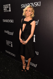 Sienna Miller took a daring turn in a Prada LBD with a cleavage-baring cutout during the Hollywood Reporter and Swarovski party.
