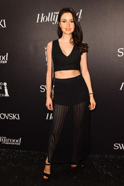 Emma Miller put her taut abs on display in a black crop-top during the Hollywood Reporter and Swarovski party.