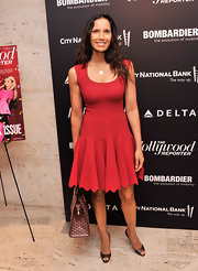 Padma Lakshmi chose this red frock that featured a wide scoop neck and a fit and flare skirt with a scalloped hem, for her evening look.