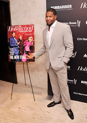 Michael Strahan chose a classic gray suit for his slick and modern look at The Hollywood Reporter's event.