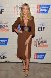 Heidi Klum showed a bit of leg and lots of cleavage in this sexy brown Michael Kors number during the Hollywood Stands Up to Cancer event.