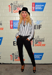 Christina Aguilera kept it casual yet chic in a black-and-white striped button-down by Theory during the Hollywood Stands Up to Cancer event.