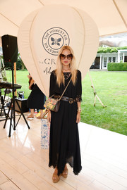Rachel Zoe chose nude cork platform sandals to pair with her dress.