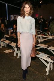 Hanneli Mustaparta was demure at the Honor fashion show in a loose pale-blue blouse.