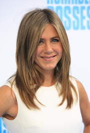 Jennifer Aniston always looks chic wearing her signature layered locks!