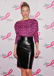 Carolyn Murphy heated things up at the Hot Pink Party in this leather pencil skirt.