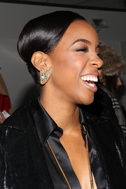 Kelly Rowland polished off her look with a sleek bobby-pinned updo during the Houghton fashion show.