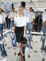 Kate Bosworth opted for a simple white polo shirt by Gant when she attended the label's presentation.