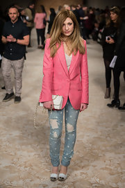 Nicola Roberts' ripped jeans had some girlie flair with white polka dots and when paired with a pink lace blazer.