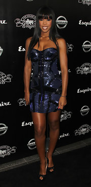 Kelly dazzled in a sequined mini dress. The black and navy blue frock complemented Kelly's glowing complexion.