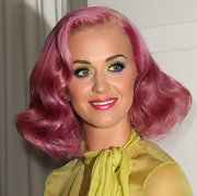 Katy Perry's wore iridescent pink lipstick to the House of Hype's 2011 MTV Video Music Awards after party. To get her look, Kat Von D Foiled Love Lipstick in 'Valentine' is a great option.