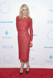 Judith Light kept it timeless in a red lace sheath dress at the Housing Works Groundbreaker Awards.