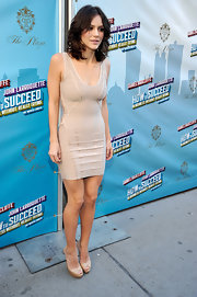 Katharine McPhee paired her nude bodycon dress with matching platform peep toes.