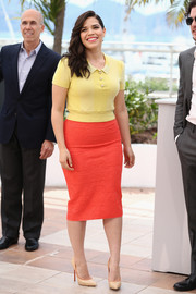 America Ferrera completed her vibrant outfit with Casadei Blade pumps in nude with orange piping.