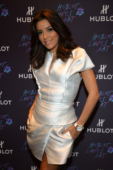 Eva Longoria matched her white mini dress with a large chronograph watch for the Hublot Art Basel event.