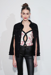 Kaia Gerber layered a sexy cutout crop-top under a black denim cape for the Hudson Jeans SS18 preview.