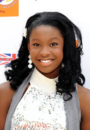 Coco Jones sported teased ringlets with a vintage flair as she attended the Annual Kidstock Benefit.